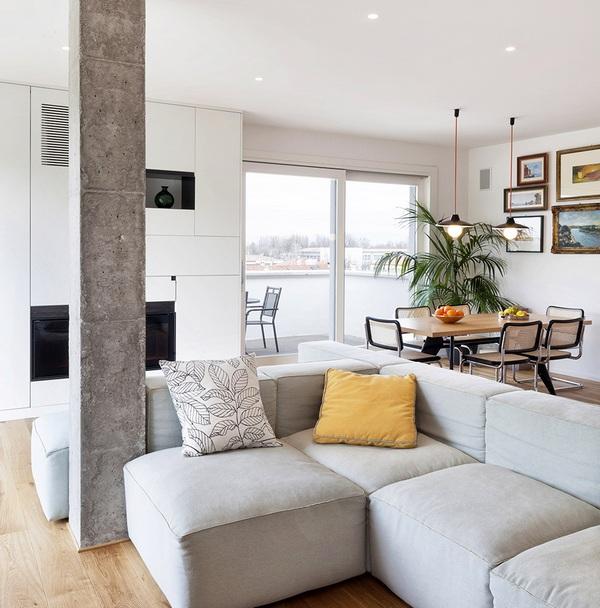 Современный и вдохновляющий интерьер, демонстрирующий обнаженные бетонные колонны